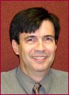 Dr. Nelson L. Passos