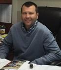 Dr. Chris A. Hansen