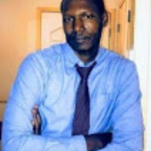 Dr. Andrew B Katumwehe